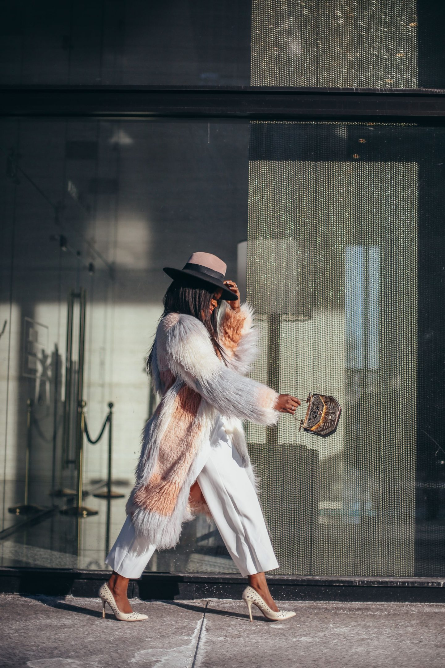 Edgy Fashion. Faux fur coat, fedora and ehite jumpsuit