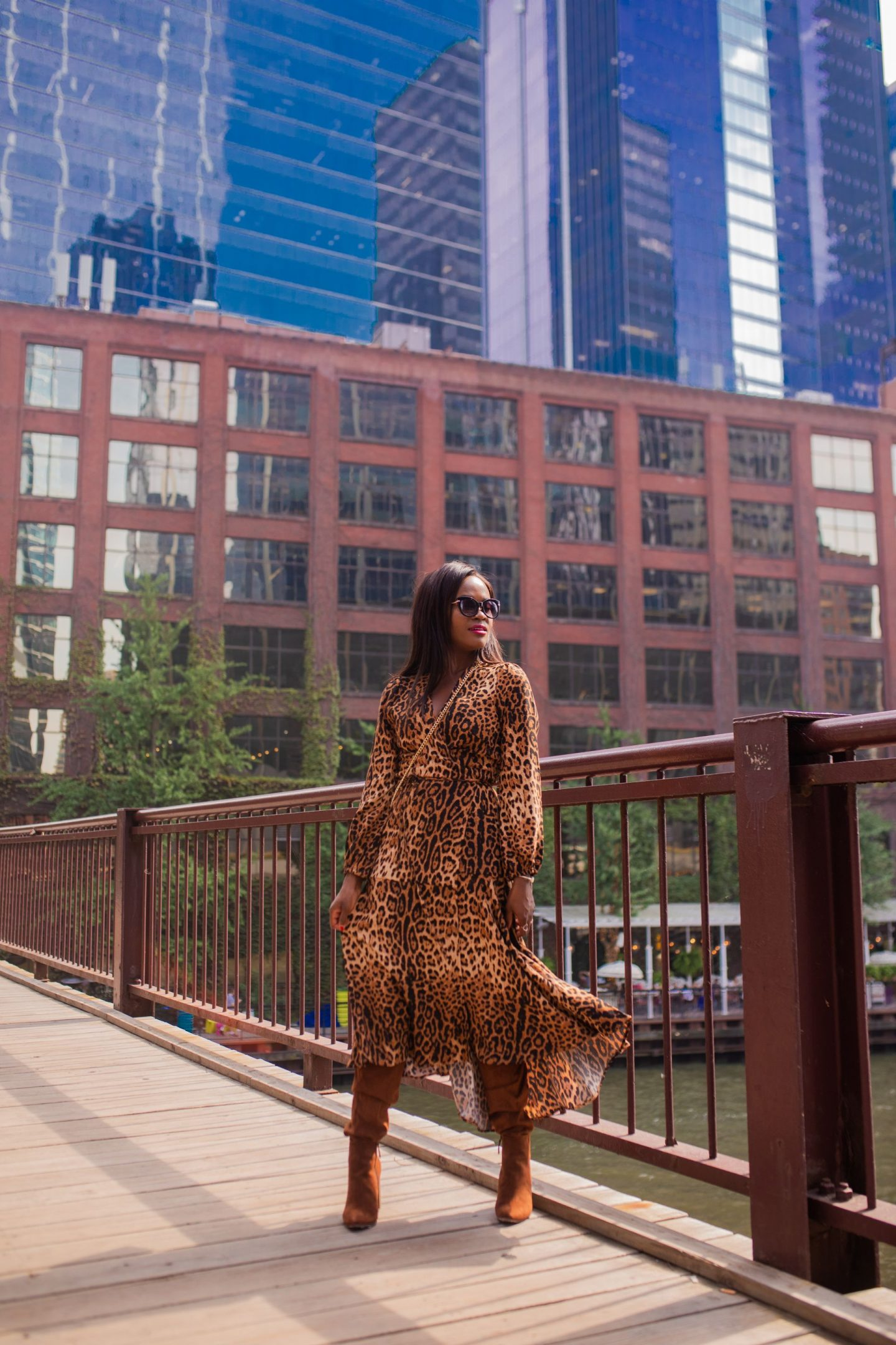Brown leopard dress and brown tall boots.