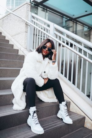 White winter boots and white fuzzy coat