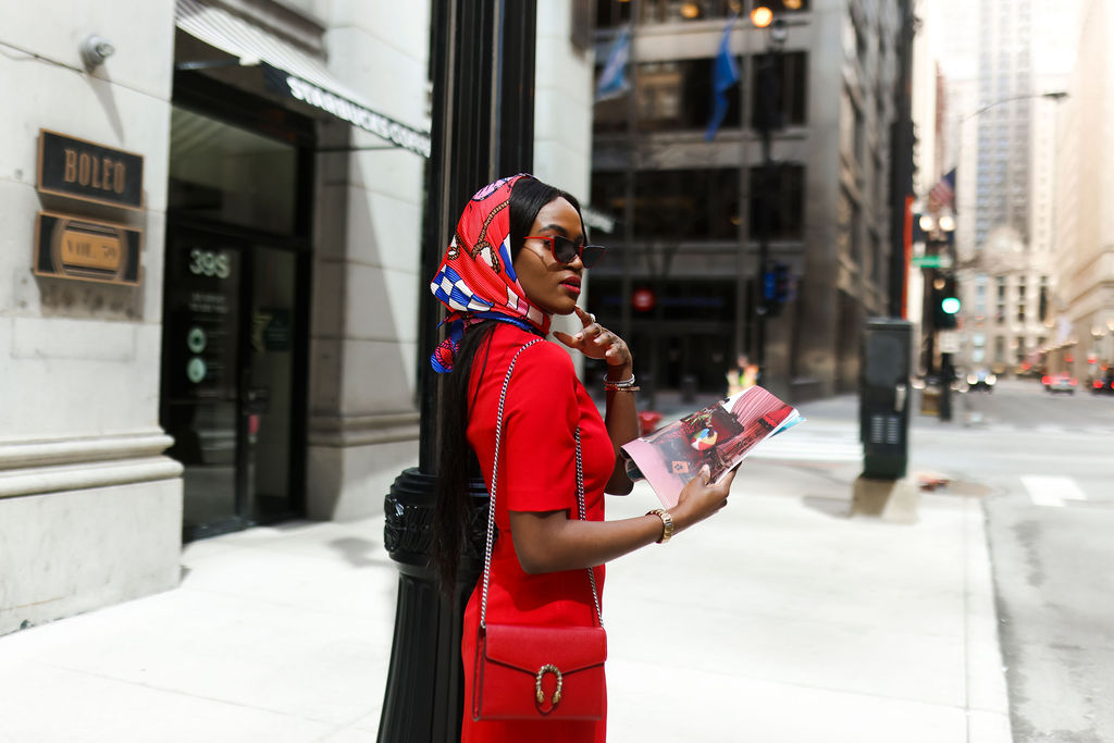 Red dress and red scarf in the city